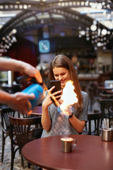 Serving Coffee With Fire Flames To Young Woman