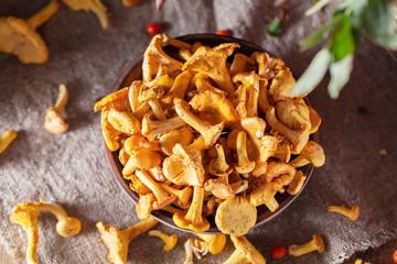 Fototapeta Fresh chanterelle mushrooms in a bowl. Top view obraz