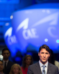 Canada's PM Trudeau speaks during a news conference at CAE Inc., in Montreal, Quebec