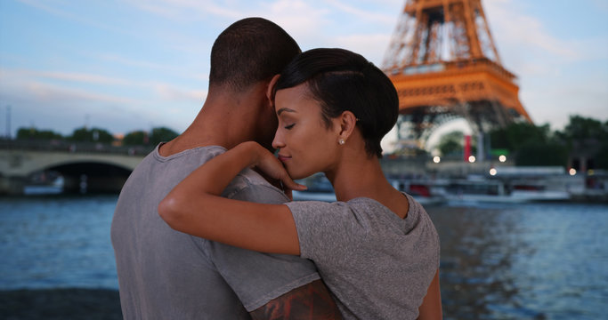 Traveling African-American couple enjoying view of Eiffel Tower together
