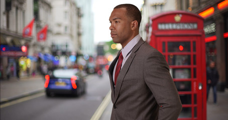 Young black businessman traveling in London takes look around the city