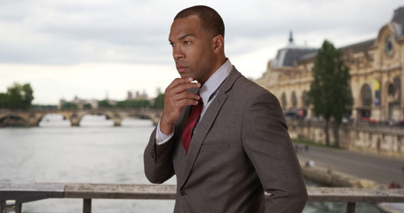 Portrait of African-American businessman thinking to himself in Paris