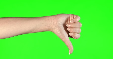 Female hand gestures on green screen: thumbs up