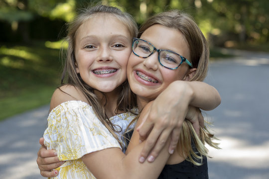 Tween Girls in Middle School Hugging