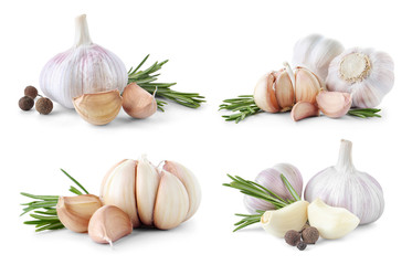 Set of different garlic bulbs and cloves on white background