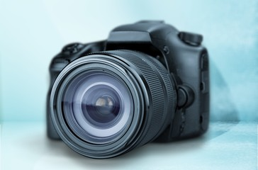 Black camera on blue background