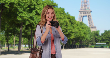 Travel photographer in Paris taking picture outside smiling