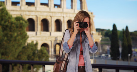 Travel photographer in Rome taking picture outside smiling