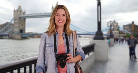 Travel photographer standing in front of Tower Bridge in London UK