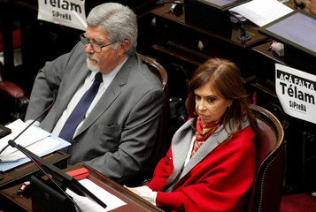 Senator and former Argentine President Cristina Fernandez de Kirchner sits next to Senator Fuentes as lawmakers debate on a bill that would legalize abortion, in Buenos Aires