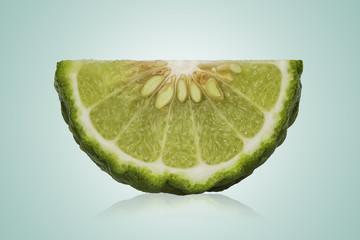 a half of fresh bergamot fruit isolated on white background