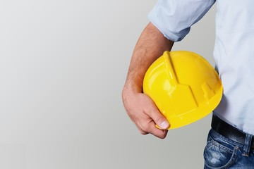 Worker man with helmet on background