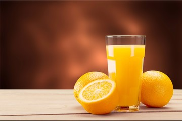 Orange juice and slices of orange on