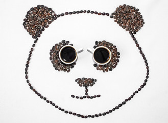 Image of a panda made from coffee beans.