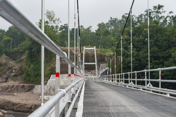 Steel suspension bridge in countryside