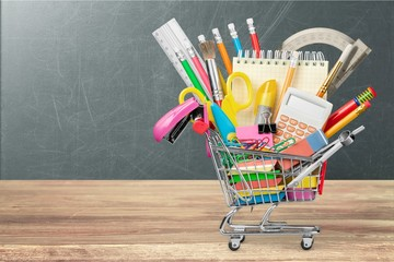 Stationery objects in mini supermarket cart