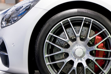 Detailing series. Clean super car disc-brake. Red rims from sports car.. Wall mural