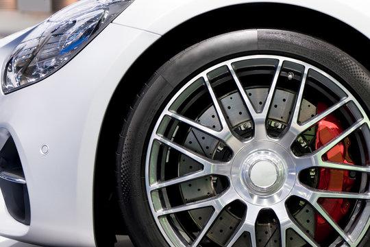 Detailing series. Clean super car disc-brake. Red rims from sports car..