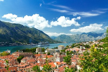 Top view of the old town and big ship in Kotor, Montenegro