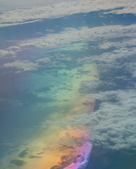 Aerial view of the Ionian sea and the Italian coast. Italia. Colors produced when light is passed through the airplane window.