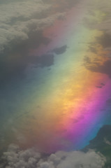 Aerial view of the Tyrrhenian sea and the Italian coast. Colors produced when light is passed through the airplane window.