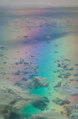 Aerial view of the Tyrrhenian sea. Colors produced when light is passed through the airplane window.