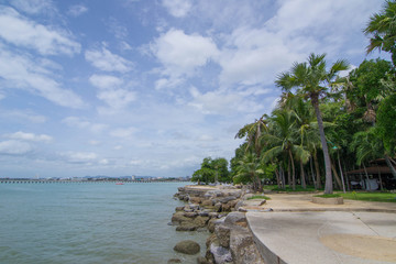 Bright scenic morning view of the boardwalk at Pattaya Beach in Thailand.