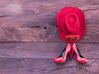 red cowboy hat on red wooden background
