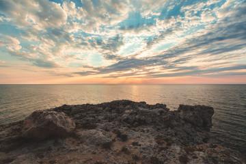 Brilliant vacation destination beach sunrise and sea cliffs background