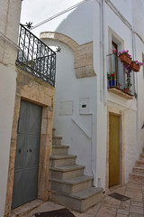 Italy, Puglia region, Locorotondo,  a whitewashed village in the Itria valley, with its medieval historical center full of stairs, balconies, flowers, arches, frescoed churches, and details