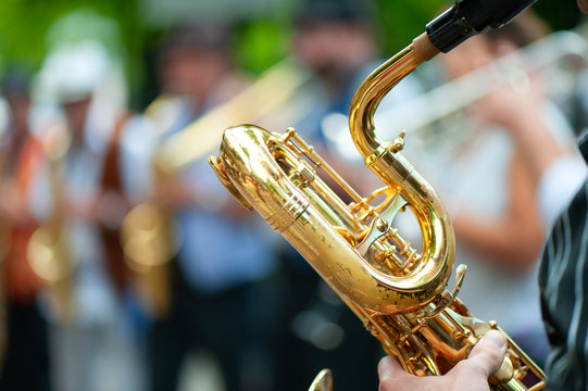 Baritone saxophone player performs street performances with his group