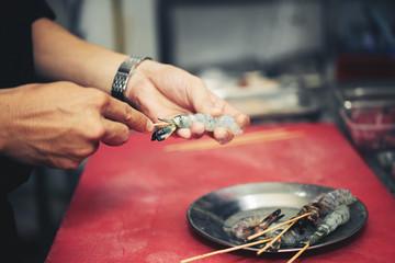 Chef making grilled shrimp