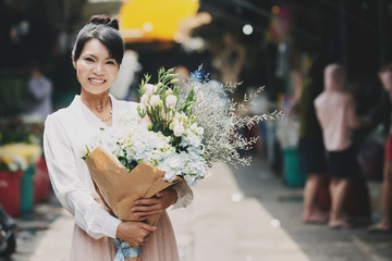 Cheerful woman with flowers