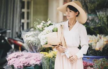 Elegant lady with flowers