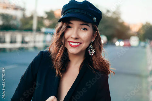 b64af28f9dc Closeup portrait of young beautiful fashionable woman with sunglasses. Lady  posing on dark grey background. Model wearing stylish cap hat