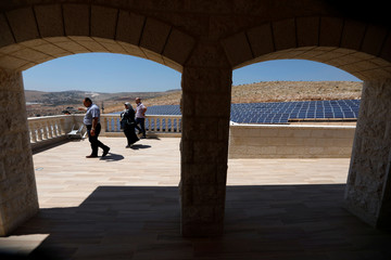 Palestinian engineer gestures at a solar plant in Tubas, in the occupied West Bank