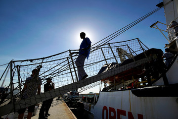 A migrant rescued by NGO Proactiva Open Arms rescue boat in central Mediterranean Sea arrives at the port of Algeciras in San Roque