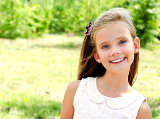 Portrait of adorable smiling little girl child outdoors
