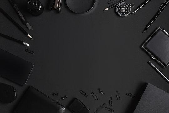 Set of black identity elements on black paper background. Black branding mockup