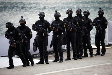 Navy combat divers perform at the National Day parade along Marina Bay in Singapore