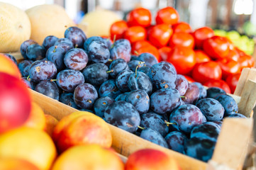 Plums and tomatoes on market