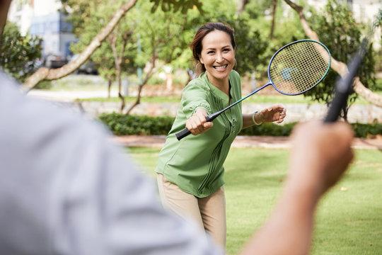 Woman enjoying game of badminton