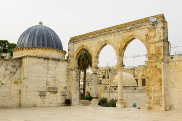 10 May 2018 Various outbuildings, walls and minarets in the stone paved courtyard surrounding the Dome of The Rock Islamic Shrine in Jerusalem Israel