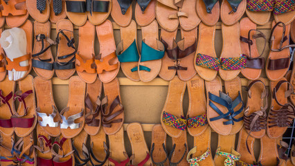 Handmade leather shoes stand in a bazaar of Morocco