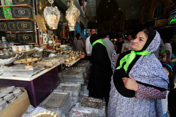 An Iranian woman is seen at the old city of Najaf