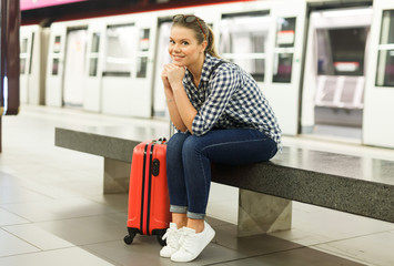 Girl sitting at metro station
