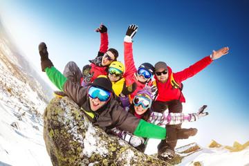 Group happy friends crazu fun ski resort