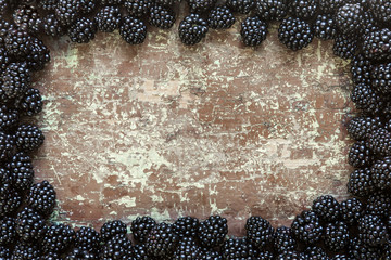 Ripe blackberries on a wooden table