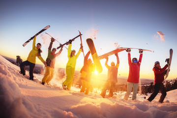 Garden Poster Winter sports Happy friends at ski resort having fun sunset