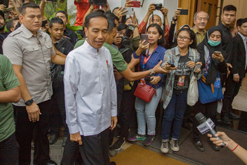 Indonesian President Joko Widodo arrives to hold a meeting with coalition party leaders in Jakarta